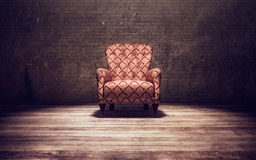 Vitage chair in an old room. Vintage chair in an old brick wall room Royalty Free Stock Photography