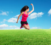 Vital and athletic girl jumps Stock Image