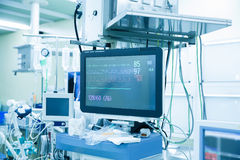 Vital functions (vital signs) monitor in an operating room. Functional vital functions (vital signs) monitor in an operating room with machines in the background stock images