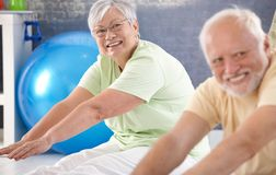 Vital old lady exercising Royalty Free Stock Photos