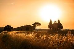 Vitaleta Chapel at sunset, Tuscan landscape near San Quirico d`Orcia, Siena, Tuscany Italy. Vitaleta Chapel at sunset, Tuscan landscape near San Quirico d`Orcia Stock Photo