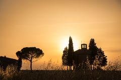 Vitaleta Chapel at sunset, Tuscan landscape near San Quirico d`Orcia, Siena, Tuscany Italy. Vitaleta Chapel at sunset, Tuscan landscape near San Quirico d`Orcia Stock Images