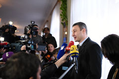 Vitali Klitschko tallking to journalist after vote in Kiev, Uktr Stock Photography