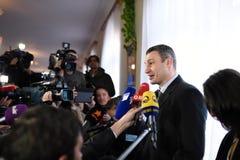 Vitali Klitschko tallking to journalist after vote in Kiev, Uktr Stock Photography