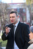 Vitali Klitschko tallking to journalist after vote in Kiev, Ukraine Stock Photo