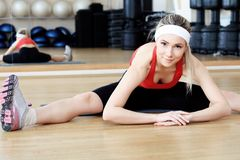 Vitality. Young sporty woman in the gym centre Royalty Free Stock Photography