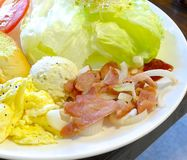 Vitality breakfast with fried eggs, bacon, tomato, toasts and fresh salad Royalty Free Stock Photography