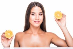 Vitality concept. Portrait of enjoyed appealing woman with citrus slices isolated on white background stock images