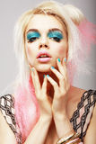 Vitality. Eccentric Blond with Theatrical Cyan Makeup. Dyed Pink Hair Royalty Free Stock Photo