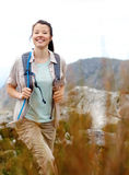 Vitality healthy lifestyle woman. Carefree brunette girl walks outdoors hiking and exploring. she is cheerful and happy royalty free stock images