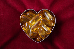Vitamin arranged in the shape of a heart Stock Photos