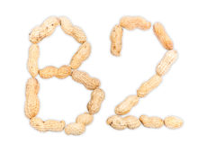 Vitamin B2 av jordnötter som isoleras på vit bakgrund Royaltyfri Fotografi