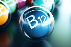 Vitamin B12, on black background. Symbol of health and longevity. 3d rendering. Vitamin B12, on black background. Symbol of health and longevity, 3d rendering Stock Images