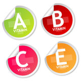 Vitamin A, B, C and E stickers Stock Photography