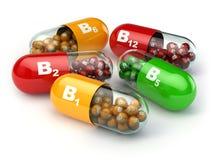 Vitamin B. Capsules B1 B2 B6 B12 on white  background. Stock Photos