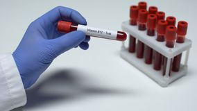 Vitamin B12-Test, Doctor Holding Blood Sample In Tube Close