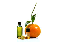 Vitamin c. Tablets and liquid bottles with orange slices Stock Photos