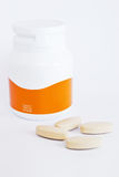 Vitamin c bottle and medicine tablets. Isolated royalty free stock photos