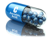 Vitamin C capsule or pill. Ascorbic acid. Dietary supplements. 3d illustration Royalty Free Stock Images