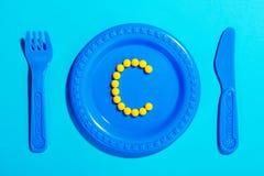 Vitamin C i barn bantar Fotografering för Bildbyråer