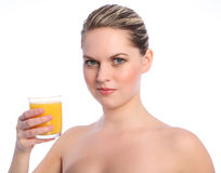 Vitamin C orange fruit juice drink for young woman Stock Image