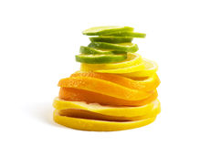 Vitamin C Overload, Stacks of sliced fruit. On white Stock Photo