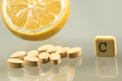 Vitamin c pill and lemon on white Stock Photography