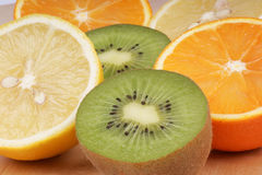 Vitamin C rich fruits. Juicy delicious fruits: lemon, orange and kiwi. Studio shot Royalty Free Stock Photos