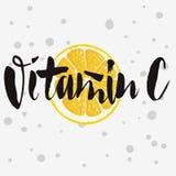 Vitamin C Rough Traced  Custom Artistic Handwritten Brush. Vitamin C Rough Traced  Custom Artistic Handwritten Brush Calligraphy Design With Sliced Lemon Royalty Free Stock Photo