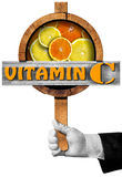 Vitamin C - Sign with Hand of Chef Stock Photo