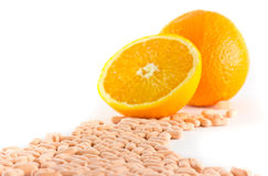 Vitamin c tablet with orange fruit. On white background Stock Images