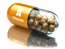 Vitamin A capsule or pill. Dietary supplements. Stock Image
