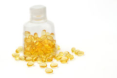 Vitamin capsules with  E poured out of bottle Royalty Free Stock Photo