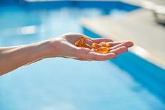 Free Vitamin D, E, A Fish Oil Capsules Cod Liver Oil Omega 3 In Female Hand Royalty Free Stock Photo - 174529235