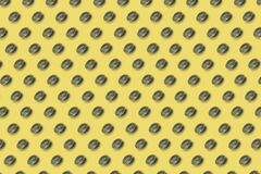 Vitamin d pattern on yellow background