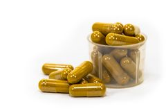 Herbal Capsule in Natural Capsule. Vitamin drug medicine pill remedy caulk stop plug nherb Herbal Medicines healthy care body diet capsule clean cure yellow stock image