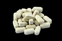 Vitamin / drug tablets. On black background Stock Photography