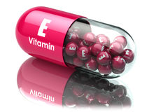 Vitamin E capsule or pill. Dietary supplements. Royalty Free Stock Images