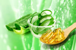 Vitamin E capsules and sliced Aloe Vera. Stock Image