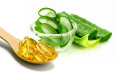 Vitamin E capsules and sliced Aloe Vera. Royalty Free Stock Image