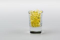 Vitamin E Pills Capsules White Background  in shot glass tight view close crop Stock Image
