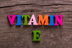 Vitamin E word made of wooden letters royalty free stock photography