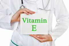 Vitamin E written on a card in doctors hands Stock Photography