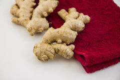 Vitamin ginger. HEALTHY KITCHEN: vitamin ginger on red towel royalty free stock image