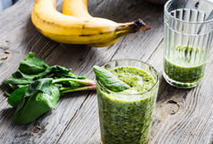Vitamin green smoothie with spinach, banana, clean eating Stock Photography