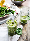 Vitamin green smoothie with spinach, banana, clean eating Royalty Free Stock Image