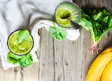 Vitamin green smoothie with spinach leaves, banana and peanut mi Royalty Free Stock Image