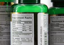 VITAMIN LABELS. View of supplement facts on the back of vitamin bottles Stock Photo