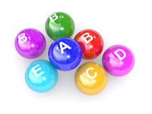 Vitamin letters on balls Royalty Free Stock Images