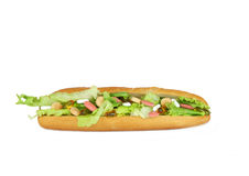 Vitamin Madness. Vitamin tablets in a french bread salad roll, set against a white background stock photos